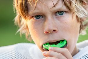 Boy with sports mouthguard